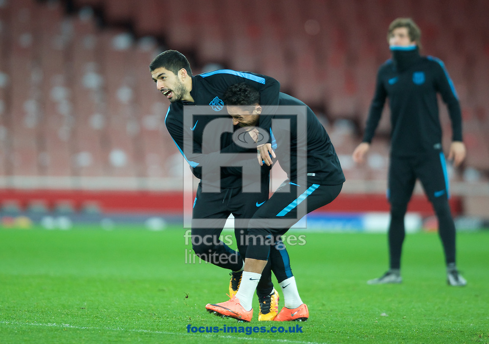 Luis Suarez (left) wrestles with Adriano during the Barcelona training session at the Emirates Stadium, prior to their Champions League match against Arsenal tomorrow. London, England.<br /> Picture by Alan Stanford/Focus Images Ltd +44 7915 056117<br /> 22/02/2016