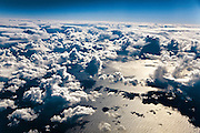 From 39,000 feet, clouds cast shadows on the North Atlantic. On the everyday commercial-jet flight, passengers looks down through the lowest level of the atmosphere, the troposphere. This layer contains 80% of our atmosphere's mass.