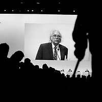 Aged shareholder addressing the annual general meeting of Credit Suisse. There was general anger at the massive bonuses paid out to senior bankers, totalling a staggering 3 billion Swiss francs ($3.12 billion), when the bank had losses of 22 billion in 2008. There was further ire at the apparent indifference to clients who were sold products link to Madoff. The bank lost almost $1 billion in the scam.