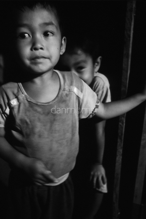 Children playing at night, Ban Pak Ou, Luang Phrabang, Laos