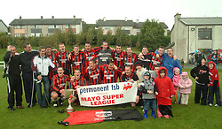 Westport Utd Super League Champions 2004 celebrate with the league cup and young generation of supporters...Photograph Conor McKeown.