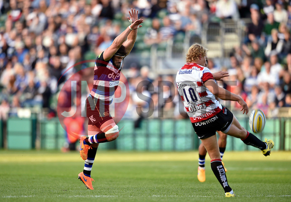 Guy Mercer of Bath Rugby puts pressure on Billy Twelvetrees of Gloucester Rugby - Mandatory byline: Patrick Khachfe/JMP - 07966 386802 - 26/09/2015 - RUGBY UNION - The Recreation Ground - Bath, England - Bath Rugby v Gloucester Rugby - West Country Challenge Cup.