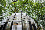 UNITED KINGDOM, London: 9 June 2015. A pop up office built around a tree is photographed in London, England. TREExOFFICE has launched a concept co-working space that utilises London's open spaces. The first office is built in Hoxton Square and is available to hire for the next seven months the office has wifi and power capability. Andrew Cowie / Story Picture Agency