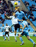 Photo: Ed Godden.<br />Coventry City v Derby County. Coca Cola Championship. 11/11/2006. Coventry's Stern John (R) leaps above Morten Bisgaard for the ball.