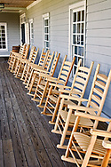 Wooden rocking chairs on porch at Labrot &amp; Graham Distillery, (Woodford Reserve)<br /> near Versailles, Kentucky