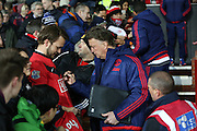Manchester United Manager Louis van Gaal signing autographs during the Barclays Premier League match between Manchester United and Stoke City at Old Trafford, Manchester, England on 2 February 2016. Photo by Phil Duncan.