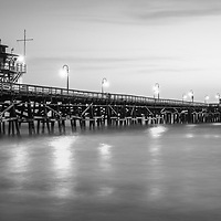San Clemente pier at sunset black and white panorama photo. San Clemente California is a popular coastal town in Orange County in the United States of America. Copyright ⓒ 2017 Paul Velgos with all rights reserved.