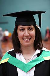 Portrait of woman in graduation gown,