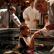 Marcos Ortiz, age 7, after his full submersion Baptism on April 3rd, 2010 at Sacred Heart Cathedral during the Holy Saturday Easter Vigil (Reverend Kevin McKenna presides).