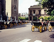 Horse and carriages in square next to cathedral, Seville, Spain 1976