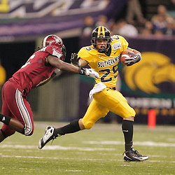 21 December 2008:  Southern Miss running back Damion Fletcher (25) stiff arms Troy defensive back Sherrod Martin (6) during a 30-27 overtime victory by the Southern Mississippi Golden Eagles over the Troy Trojans in the  R+L Carriers New Orleans Bowl at the New Orleans Superdome in New Orleans, LA.