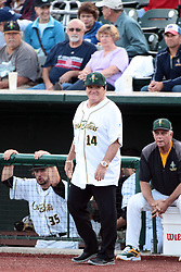 09 July 2015: Pete Rose know affectionately to fans as Charlie Hustle the current Major League Baseball all time hits leader exits the CornBelters dugout as manager for the night to take his place in the first base coaches box. Pete Rose night during a Frontier League Baseball game between the Schaumburg Boomers and the Normal CornBelters at Corn Crib Stadium on the campus of Heartland Community College in Normal Illinois