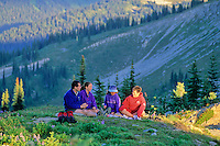 A family enjoys a picnic in an alpine meadow during a hike on Whistler Mountain, late summer, Whistler, BC Canada.