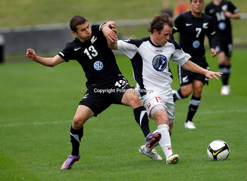 NZFC's Chad Coombes tagles with NZ A's Costa Barbarouses. Football, New Zealand A v NZFC All Stars, North Harbour Stadium, Albany, Sunday 9th May 2010. Photo: Shane Wenzlick/PHOTOSPORT