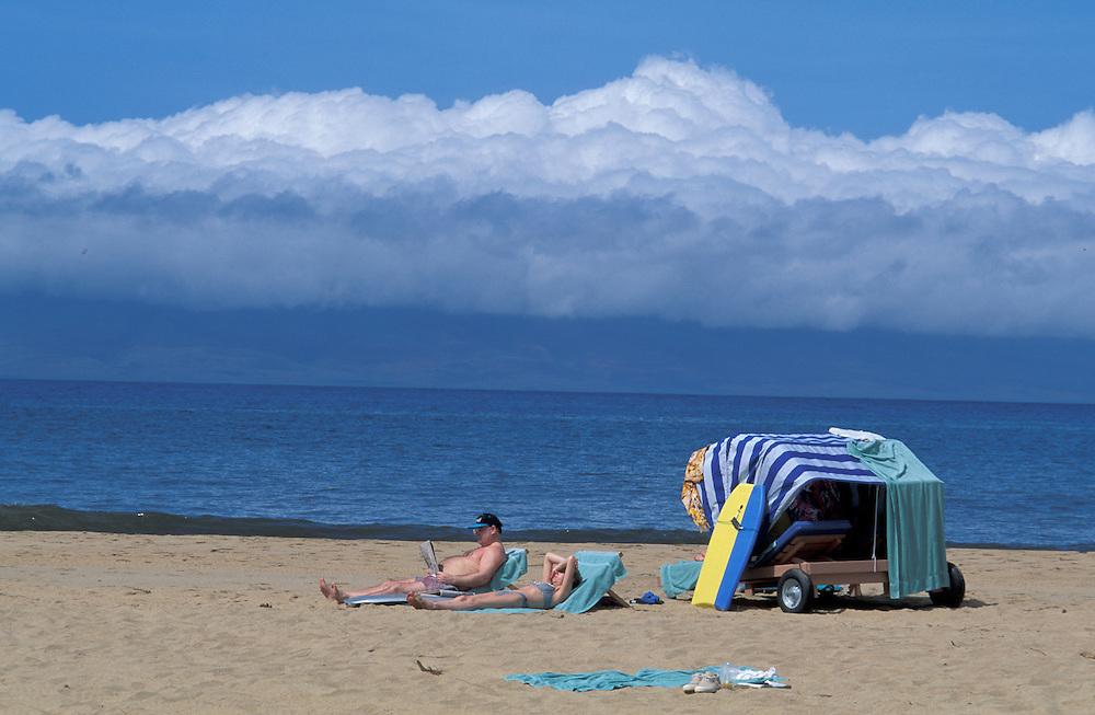 Couple sunbathing, Kaanapali Beach, Maui, Hawaii, USA