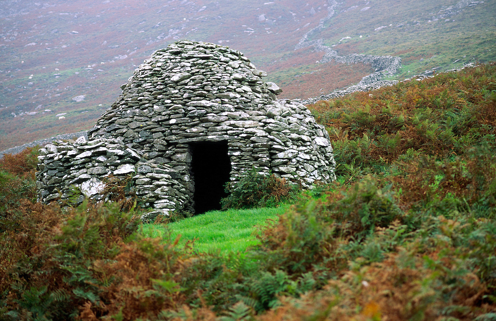 Prehistoric Celtic dry stone wall corbelled beehive hut. Part of the Fahan group west of Dingle, County Kerry, Ireland.