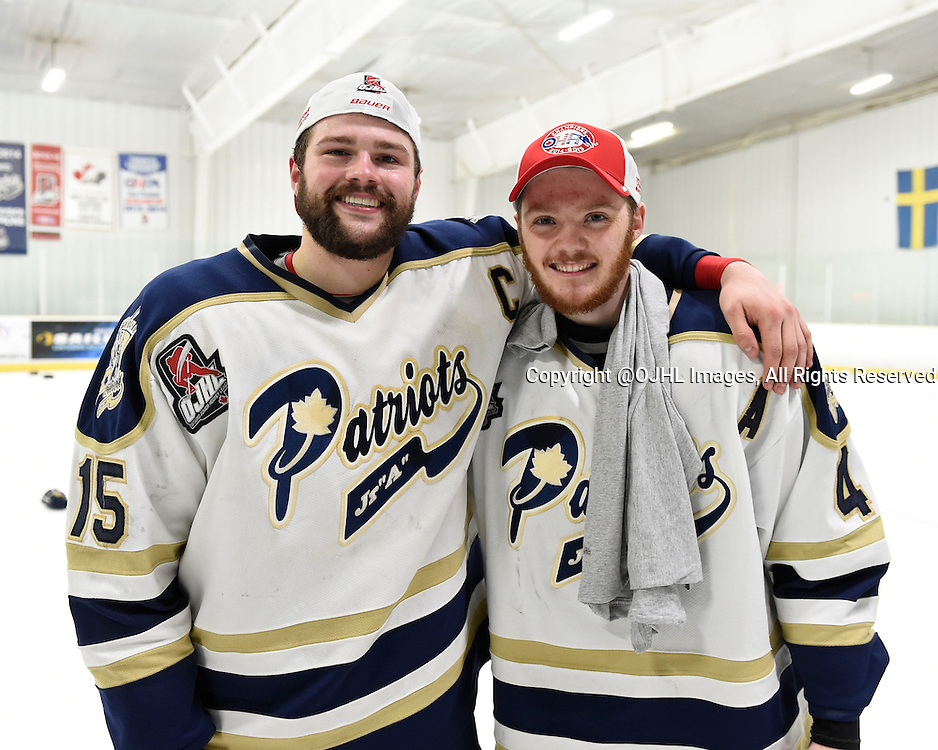 TORONTO, ON - Apr 22, 2015 : Ontario Junior Hockey League game action between the Toronto Patriots and the Kingston Voyaguers. Game seven of the Buckland Cup Championship Series. Luke Carter #15 and Tyler Currie #4 of the Toronto Patriots together after winning the Buckland Cup.<br /> (Photo by Andy Corneau / OJHL Images)
