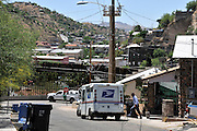 A US postal worker delivers mail to a residence near the border wall in Nogales, Arizona, USA, which is across the international line from Nogales, Sonora, Mexico.