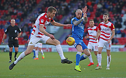 Marcus Maddison of Peterborough United challenges for the ball with Tom Anderson of Doncaster Rovers - Mandatory by-line: Joe Dent/JMP - 09/02/2019 - FOOTBALL - The Keepmoat Stadium - Doncaster, England - Doncaster Rovers v Peterborough United - Sky Bet League One