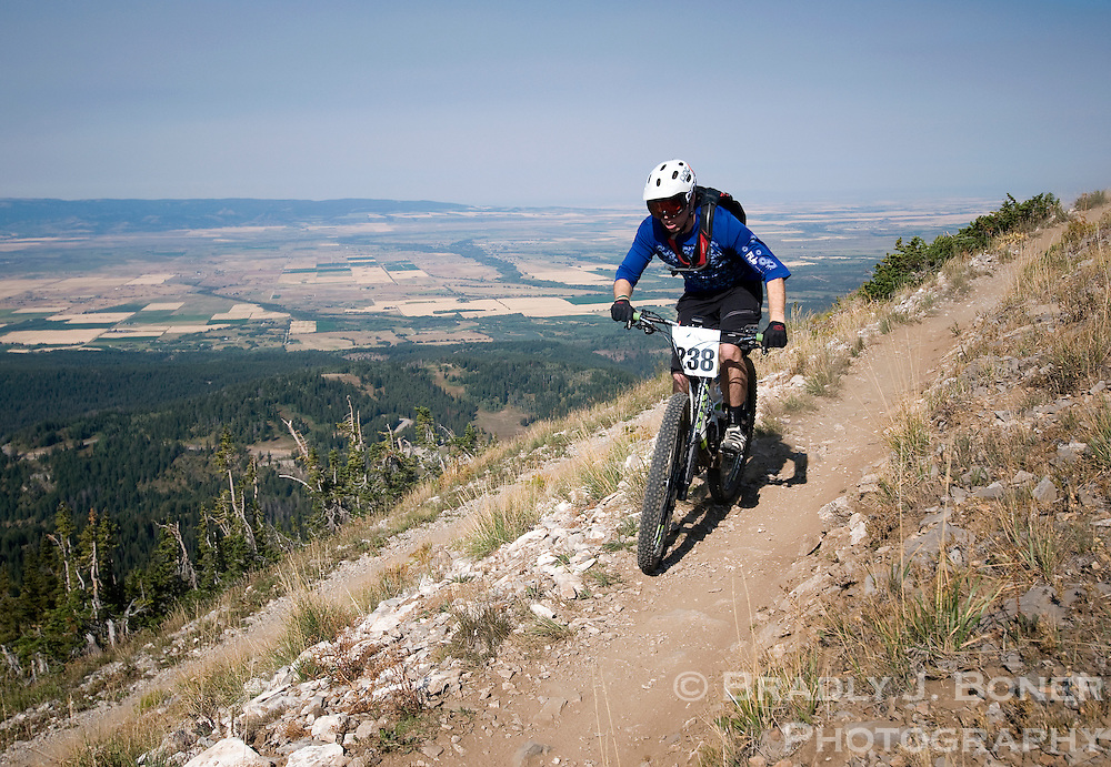 BRADLY J. BONER / NEWS&amp;GUIDE <br /> With Teton Valley, Idaho, as a backdrop, Aaron Gruzmacher of Jackson navigates the downhill course at Grand Targhee Resort on Sunday on his way to a second-place finish in the 19-39 Expert division of the Wydaho Super D race.
