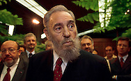 Fidel Castro, President of Cuba, speaks to the press after meeting with Louis Michel, (left) Belgian Foreign Minister and President of the European Council of Foreign Ministers, in Havana, Thursday, August 23rd, 2001. (Photo © Jock Fistick)