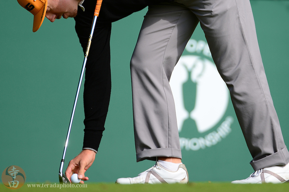 July 20, 2012; St. Annes, ENGLAND; Hunter Mahan places his ball on the tee box on the 1st hole during the second round of the 2012 British Open Championship at Royal Lytham & St. Annes Golf Club.
