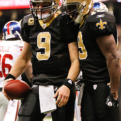November 28, 2011; New Orleans, LA, USA; New Orleans Saints quarterback Drew Brees (9) and wide receiver Devery Henderson (19) celebrate following a touchdown against the New York Giants during the second half of a game at the Mercedes-Benz Superdome. The Saints defeated the Giants 49-24. Mandatory Credit: Derick E. Hingle-US PRESSWIRE