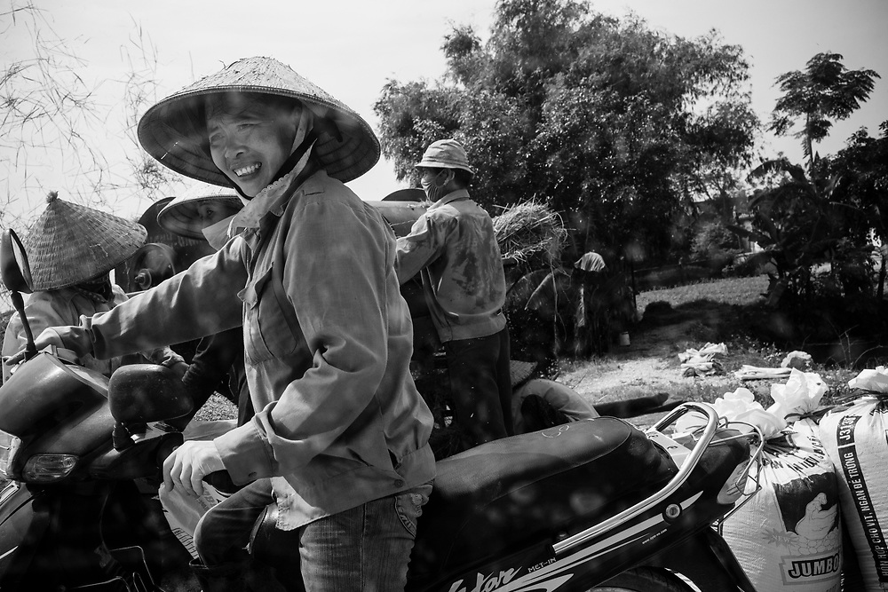 Rice farmers prepare bags of rice in Ninh Binh, Vietnam.