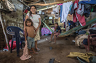 A family poses in their home in La Mariposa Las Flores Lempira, Honduras, Oct 6, 2014. Central America Medical Outreach (CAMO),  a humanitarian organization that brings life-saving medical services, education and community development to homes such as this one. Photo Ken Cedeno