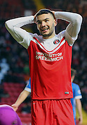 Tony Watt after a miss during the Sky Bet Championship match between Charlton Athletic and Brighton and Hove Albion at The Valley, London, England on 10 January 2015. Photo by Matthew Redman.