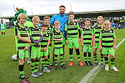 The FGR Ambassadors with club captain Aarran Racine(21) during the Vanarama National League match between Forest Green Rovers and Barrow at the New Lawn, Forest Green, United Kingdom on 1 October 2016. Photo by Shane Healey.