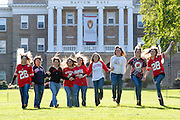 Nine soon-to-graduate college friends gather for a group portrait and run down Bascom Hill at the University of Wisconsin-Madison on May 18, 2006.