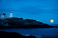 On March 19, 2011 a Super Moon rose in the eastern skyline.   Nubble Lighthouse, York, Maine.