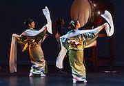 "Fujinami Kai dancers Michelle Sugahiro (left) and Kanchiye Fujima perform at the Portland Taiko concert ""Three: 3 conversations with Taiko"", Winningstad Theatre, Portland Center for the Performing Arts, Portland, Oregon."