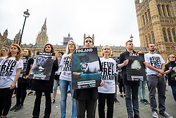 © Licensed to London News Pictures. 04/06/2018. London, UK. Activists stage a silent protest outside Parliament calling for a ban on fur. MPs are to debate the introduction of a ban on fur imports. Photo credit: Rob Pinney/LNP