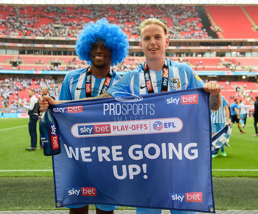 Coventry City's Kyel Reid (32) and Coventry City's Jordan Maguire-Drew (17) celebrate after winning the League 2 Play-Off final  during the EFL Sky Bet League 2 play-off final match between Coventry City and Exeter City at Wembley Stadium, London, England on 28 May 2018. Picture by Jon Hobley.