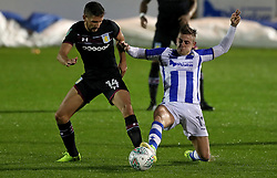 Aston Villa's Conor Hourihane (left) and Colchester United's Sammie Szmodics battle for the ball during the Carabao Cup, First Round match at the Weston Homes Community Stadium, Colchester.
