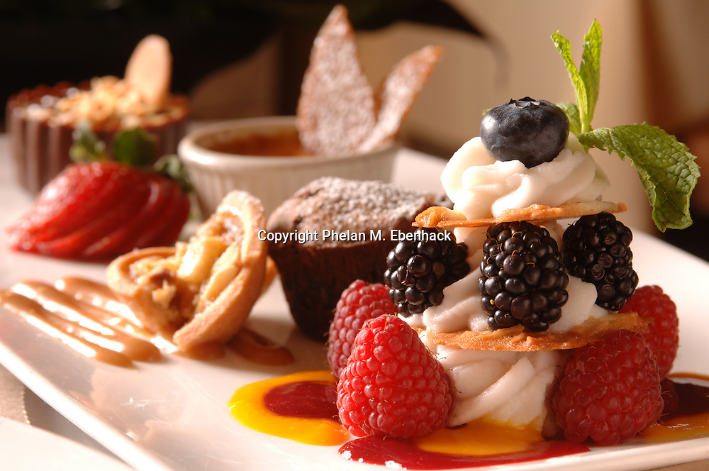 A photo of raspberry, blackberry and blueberry mille feuille dessert.