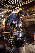 Agness Daudi, 50 years old, cooks with her clean cookstove that uses coal to prepare lunch for her family. Agnes purchased her cookstove from Solar Sister entrepreneur Julieth Mollel. Julieth is Agness&rsquo;s neighbor and friend. Julieth has had a lot of success selling the products to her community that consists of small scattered farms. Julieth has walked as far as 20 kilometers in her area to sell the stoves and the lanterns. She also sells the lanterns and cookstoves at the market.<br /> <br /> Julieth&rsquo;s personal world is brighter because, as a Solar Sister entrepreneur near Arusha, Tanzania, she earns enough money to send her grandchildren to school. Until she started working for Solar Sister in Tanzania life was becoming almost unbearable for Julieth. Cooking over her traditional cook stove made of three stones and an open fire pit put out a lot of smoke that she breathed in when she cooked breakfast, lunch and dinner for her family. <br /> <br /> Julieth has been working for Solar Sister almost since it opened in Tanzania in 2013, almost three years at this time. She heard about the solar lanterns and the opportunity to sell the lanterns and thought she could give it a try. She also learned about the cookstoves and tried the wood cookstove herself first. She soon saw that it used much less fuel than the traditional way of cooking and that she did not have to gather as much firewood. She was also pleased that it put out very little smoke. She decided that she could sell these solar lanterns and cookstoves herself. She has had a lot of success selling the products to her community which consists of small scattered farms. <br /> <br /> Julieth is helping to support her grandchildren to go to school and her granddaughter Ritha just graduated from a private primary school and is taking exams to get into the secondary school. While she still supplements her income by selling crops she is able to have a little savings put aside from her Solar Sister sales. Sh