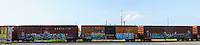 Railway Boxcars with Graffiti. (63898 x 14253 pixels)