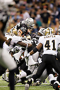 NEW ORLEANS, LA - OCTOBER 12:   Justin Fargas #25 of the Oakland Raiders leaps over tacklers against the New Orleans Saints at the Louisiana Superdome on October 12, 2008 in New Orleans, Louisiana.  The Saints defeated the Raiders 34-3.  (Photo by Wesley Hitt/Getty Images) *** Local Caption *** Justin Fargas