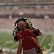 A baby watches the game from his mother's arms.<br /> <br /> Todd Spoth for The New York Times.