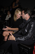 Joely Richardson and James Purefoy. Julian Macdonald fashion show. Science Museum. London. 20 September 2001. © Copyright Photograph by Dafydd Jones 66 Stockwell Park Rd. London SW9 0DA Tel 020 7733 0108 www.dafjones.com