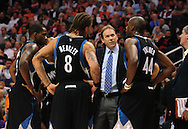 Apr. 11, 2011; Phoenix, AZ, USA; Minnesota Timberwolves head coach Kurt Rambis talks with forward Anthony Tolliver (44) ,  forward Michael Beasley (8) ,  and guard Martell Webster during a timeout against the Phoenix Suns at the US Airways Center. Mandatory Credit: Jennifer Stewart-US PRESSWIRE