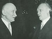 Konrad Adenauer (1876-1967), German Chancellor, right, and Robert Schuman (1886-1863), French Foreign Minister meeting, 27 May 1952.