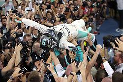 Mercedes' Nico Rosberg celebrates winning the Formula One world championship during the Abu Dhabi Grand Prix at the Yas Marina Circuit, Abu Dhabi.