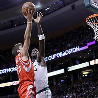 06 March 2012: Houston Rockets forward Chandler Parsons (25) goes for the layup over Boston Celtics power forward Kevin Garnett (5) during the Boston Celtics 97-92 (OT) victory over the Houston Rockets at the TD Garden, Boston, Massachusetts, USA.