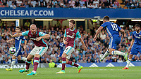 Football - 2016/2017 Premier League - Chelsea V West Ham United. <br /> <br /> Eden Hazard of Chelsea has an attempt at goal at Stamford Bridge.<br /> <br /> COLORSPORT/DANIEL BEARHAM