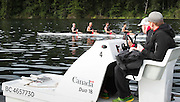 Canadian Olympic rowing coach Martin McElroy and Strength & Conditioning coach Nick Clarke (right) keep a close eye on the mens four that will represent Canada at the Rio Olympic games (left to right) Will Crothers,  Tim Schrijver, Conlin McCabe and Kai Langerfeld during a morning training session on Elk Lake in Victoria, British Columbia on June 22, 2016.