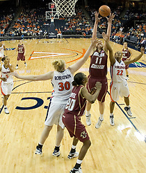 BC's Kathrin Ress (11) grabs a rebound from UVA's Monica Wright (22).  The Cavaliers defeated the Eagles 65-63 in overtime at the John Paul Jones Arena in Charlottesville, VA on January 14, 2007.